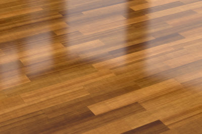 closeup of laminate flooring that looks like hardwood