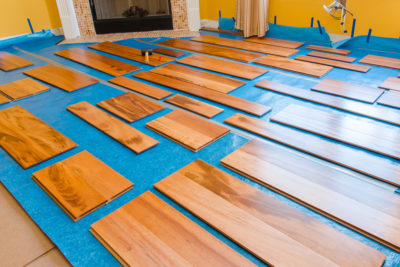 Engineered hardwood flooring planks laid out to be installed
